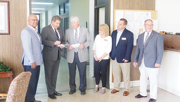 City Councilman Chris Walker, ADECA Director Jim Byard, Mayor Jim Staff, Councilwoman Susan Smith, Councilman Chris Harrison and Utilities Board Manager Kenny Smith. | Allison Brown/ Atmore Advance