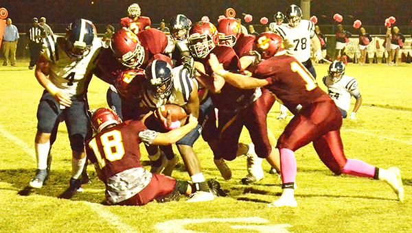 A host of Escambia Academy defenders tackle Bessemer Academy's Thomas Sims. | Andrew Garner/Atmore Advance