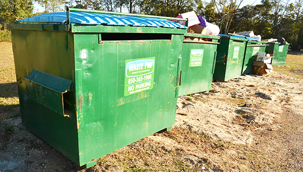 Shown here are the Waste Pro recycling bins with narrow slots for materials that need to be broken down. | Andrew Garner/Atmore Advance