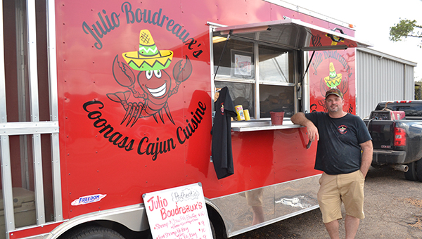 Shown is Paul Uriegas standing in front of his food truck. Uriegas owns Julio Boudreaux's Coonas Cajun Cuisine. | Andrew Garner/Atmore Advance