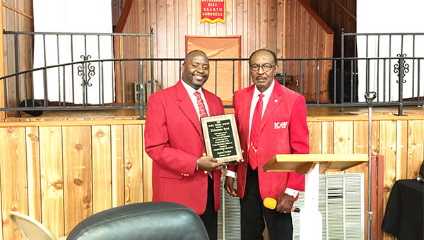 Dr. Zickeyous Byrd, left, is presented with a plaque for his contributions to Atmore's education system by Dr. Ullyesses McBride. |                    Blake Bell/Atmore Advance